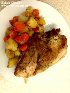 Plated baked, bone-in chicken breast with carrots and potatoes